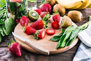 Bilder Messer Chinesische Stachelbeere Beere Erdbeeren Schneidebrett Geschnitten das Essen