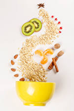 Images Oatmeal Creative Kiwi Nuts Star anise Illicium Cinnamon Colored background Grain Food
