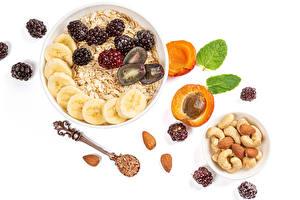 Desktop wallpapers Oatmeal Nuts Blackberry Apricot Plums Muesli White background Spoon Grain Food