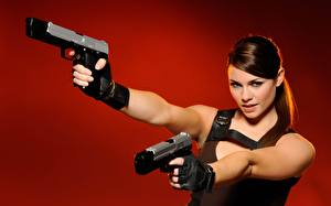 Pictures Pistol Cosplay Red background Glance Hands Glove Lara Croft Alison Carroll Girls
