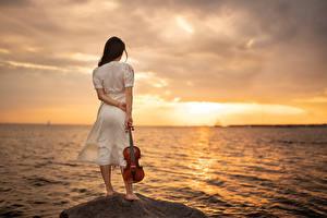 Photo Sea Sunrise and sunset Stone Violin Dress Yaroslav Kotov young woman Nature