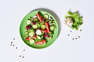 Picture Vegetables Salads Allium sativum Black pepper White background Plate
