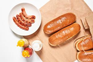 Sfondi desktop Salsicce di Vienna Panini dolci Piatto Il sale Cibo