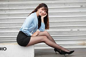 Wallpapers Asiatic Brown haired Sitting Smile Stilettos Legs Skirt Blouse Staring Girls