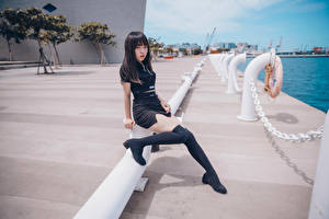 Pictures Asiatic Waterfront Sitting Legs Knee highs Uniform Glance female