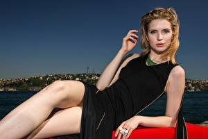 Pictures Blonde girl Esting Glance Hands Dress Legs Pose