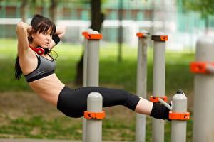 Images Fitness Blurred background Workout Uniform Headphones Hands Legs Girls
