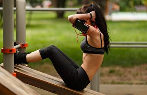 Picture Fitness Physical exercise Pose Side Brunette girl Hands Legs Smartphone female