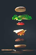 Images Hamburger Buns Rissole Knife Vegetables Gray background Food