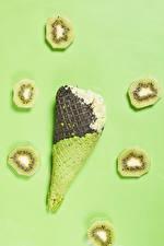 Images Ice cream Kiwi Colored background Ice cream cone Pieces