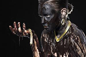 Images Jewelry Necklaces Mud Black background Glance Hands female