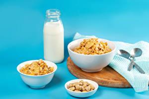 Pictures Milk Muesli Nuts Colored background Bottles Spoon Food