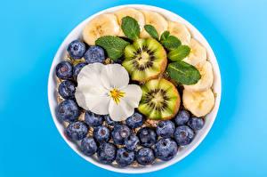 Image Muesli Blueberries Bananas Kiwi Colored background