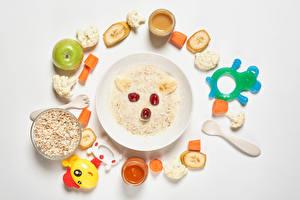 Pictures Porridge Creative Toy Apples Vegetables Fruit White background Plate Grain