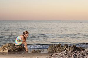 Wallpaper Sunrises and sunsets Sea Stones Dress Sit young woman