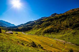 Bureaubladachtergronden Zwitserland Bergen Hemelgewelf Zon