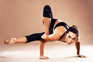 Desktop wallpapers Yoga Posing Hands Legs Brunette girl Glance Girls