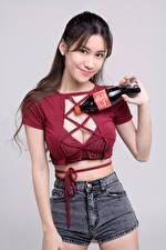 Pictures Asian Pose Smile Shorts Bottle Singlet Glance Gray background Girls