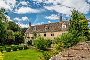Bureaubladachtergronden Engeland Huizen Een dak Down Ampney