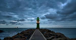 Fotos Deutschland Küste Leuchtturm Meer Abend Wolke  Natur