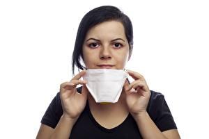 Fotos Masken Coronavirus Weißer hintergrund Brünette Starren Hand Mädchens