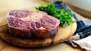 Bureaubladachtergronden Vleesproducten Snijplank Stuk van Onscherpe achtergrond steak spijs