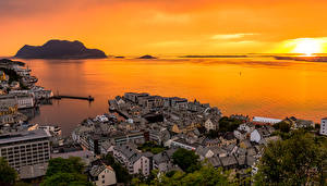 Images Norway Sunrise and sunset Evening Coast Houses Alesund Cities