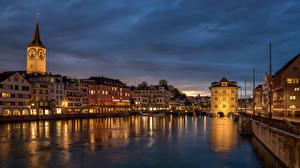 Bureaubladachtergronden Zwitserland Zürich Gebouwen Rivieren Waterfront Een toren Limmat River een stad
