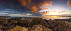 Image United Kingdom Coast Stone Sunrise and sunset Sky Wales Clouds Porth Nobla
