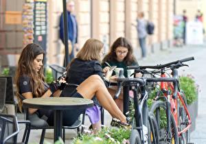 Bilder Bokeh Braunhaarige Tisch Sitzen Café Fahrrad Mädchens