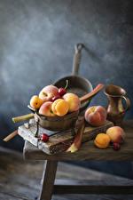 Bakgrundsbilder på skrivbordet Frukt Aprikos Körsbär Persikor Mat