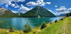 Bakgrundsbilder på skrivbordet Italien Berg Insjö Alperna Molnen Lago di Livigno