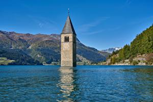 Bilder Insjö Berg Italien Ett torn Reschensee, South Tyrol, Reschensee Lago di Resia Natur bilder