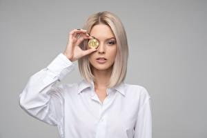 Photo Money Bitcoin Gray background Blonde girl Staring Hands Girls