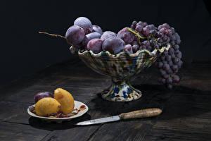 Fotos Pflaume Trauben Messer Zitrone Vase Lebensmittel