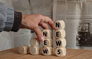 Fondos de escritorio Mano Hexaedro regular Texto Inglés Prensa escrita new news